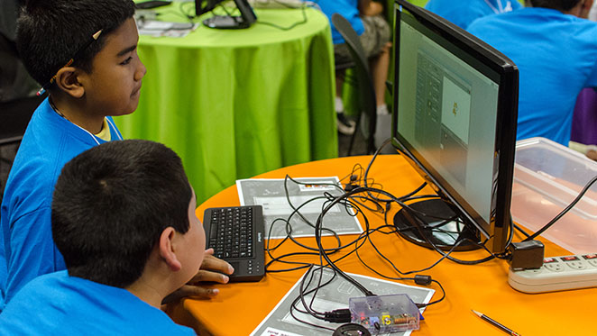 Students explore programming games on Raspberry Pi.