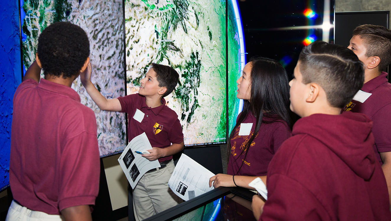 Students explore the world through the Google Liquid Galaxy Display in the Museum.