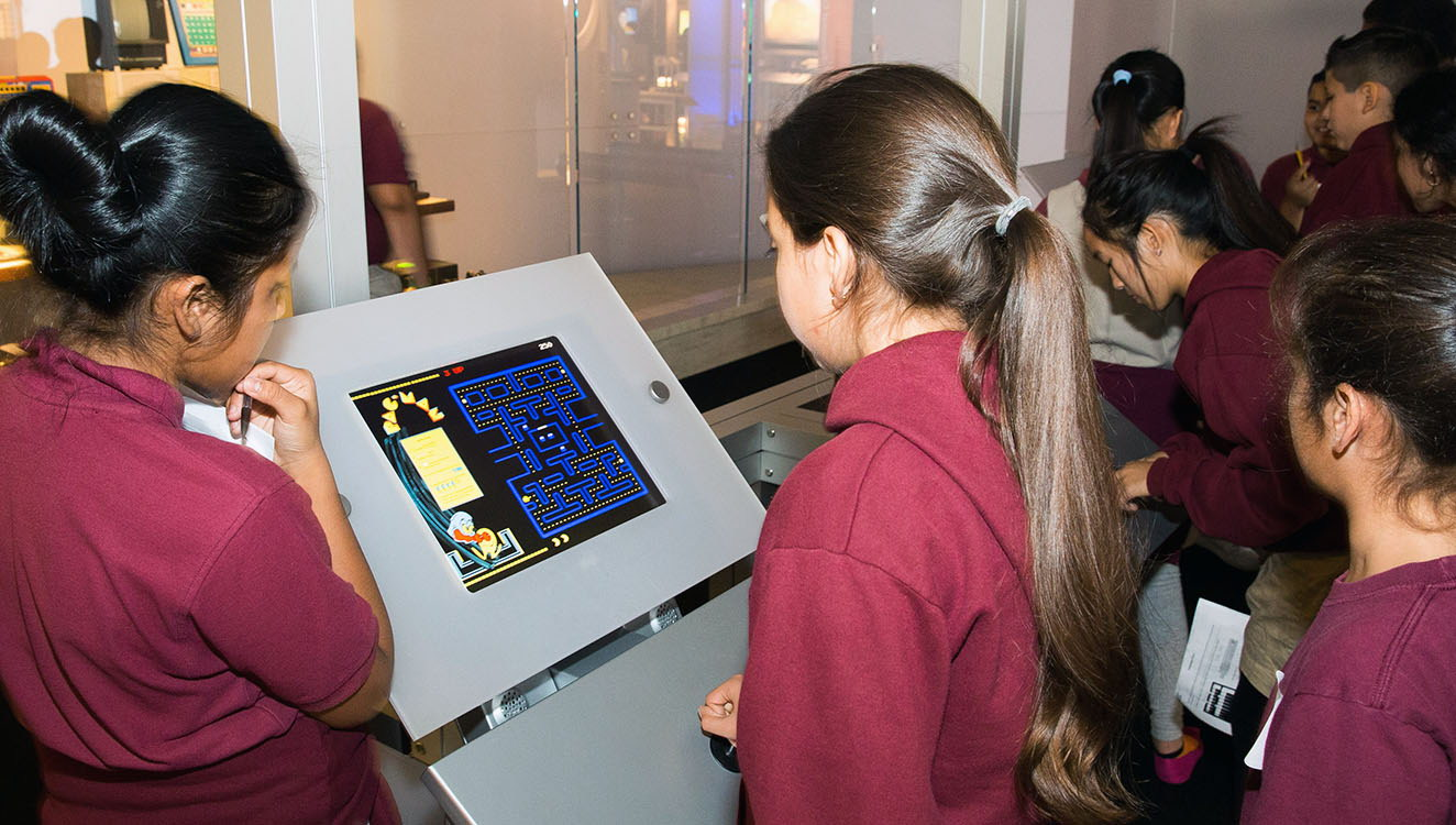 Inside <em>Revolution</em>, students experience classic video games like Pac-Man, seen here.