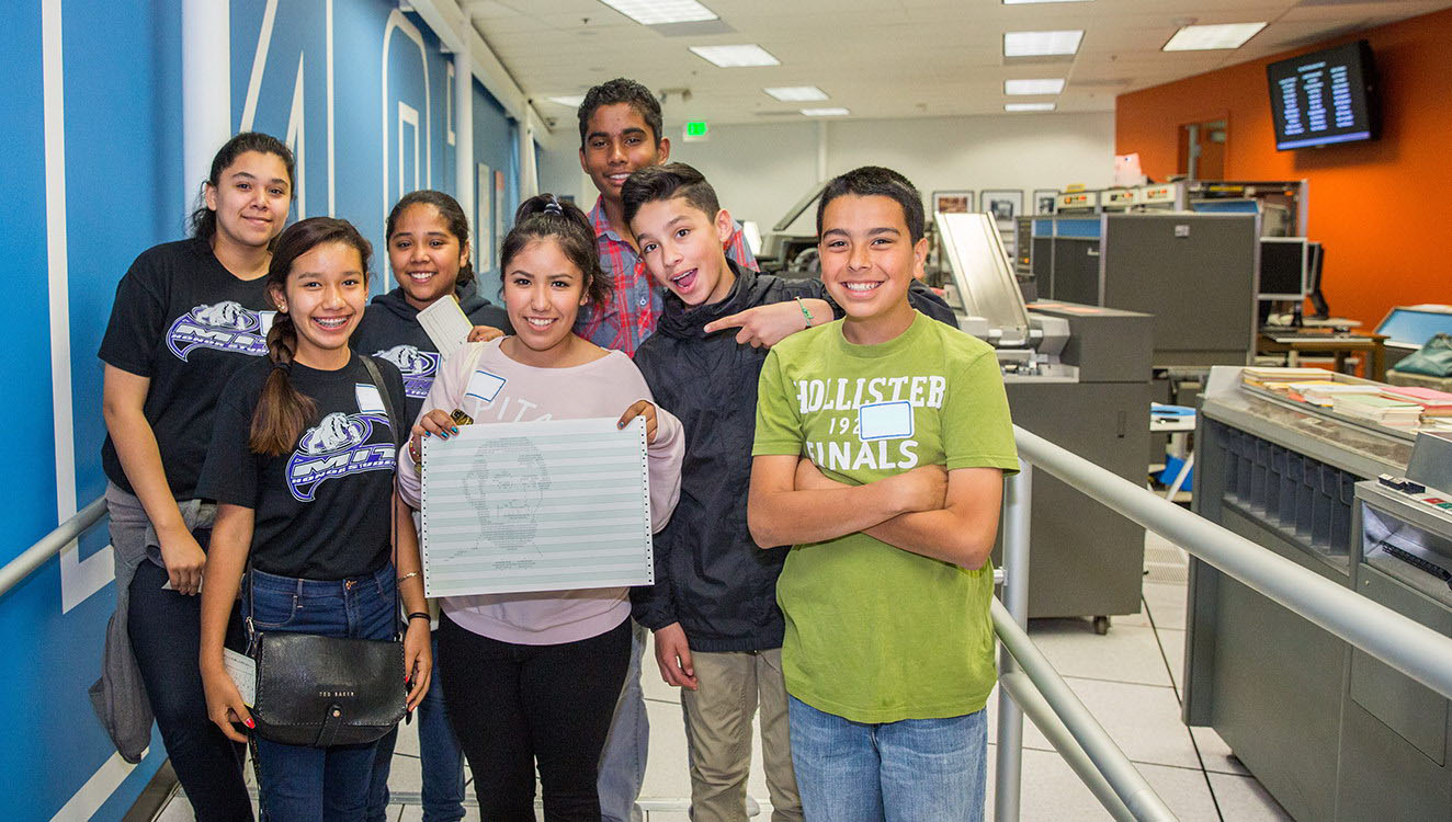 Students from McKinley Institute for Technology show off a printout of Abraham Lincoln from the IBM 1401 demonstration.