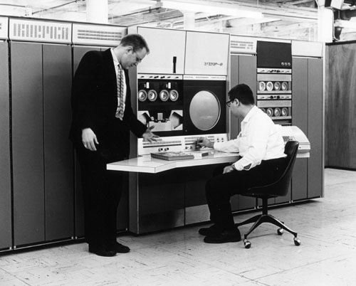 Gordon Bell (standing) and Alan Kotok at a DEC PDP-6 computer, ca. 1963